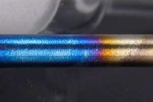 High grade titanium will oxidize in an even gradient from blue to silver